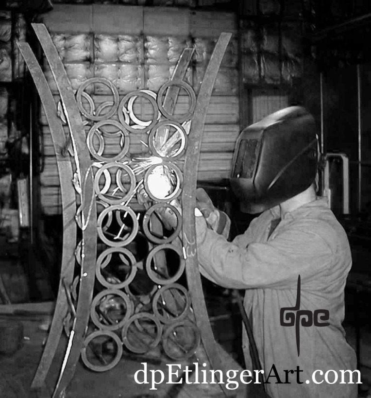 Darren welding on Chamber wine rack-grayscale-cropped-dpEart & logo-9-29-03 copy